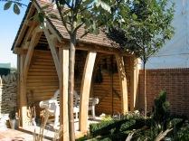 carpenter, carpentry, oak garden shelter, green oak, oak buildings, traditional timber frame, cruck frame, Dordogne, France