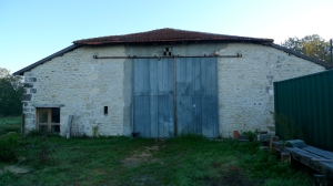barn conversion, oak lintel, limestone walls, building in France, timber framing